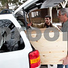 Beck Diefenbach – bdiefenbach@daily-chornicle.com<br /> <br /> Kevin, center, and his father David Ballantine discuss how to fit the finished dresser into the back of Kevin's car for his drive back to college in New York on Jan 16, 2009.