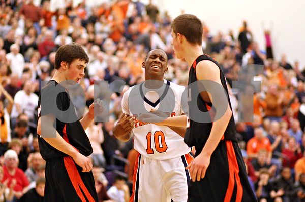 Beck Diefenbach - bdiefenbach@daily-chronicle.com<br /> <br /> Oswego's Brandon Collier (10, right) reacts after he is called for fouling DeKalb's Brian Sisler (22, left) during the fourth quarter of the sectional championship game at Hampshire High School in Hampshire, Ill., on Friday March 12, 2010. Oswego defeated DeKalb 57 to 51, ending the Barb's season.