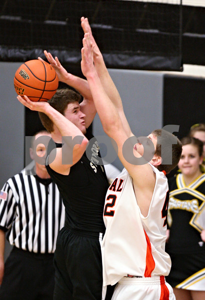 Beck Diefenbach - bdiefenbach@daily-chronicle.com<br /> <br /> Sycamore's Joe Strack (2, left) attempts to shoot the ball over DeKalb's Jordan Threloff (42, right) during the fourth quarter of the IHSA Class 3A regional semifinal game against Sycamore at Kaneland High School in Maple Park, Ill., on Tuesday March 2, 2010.