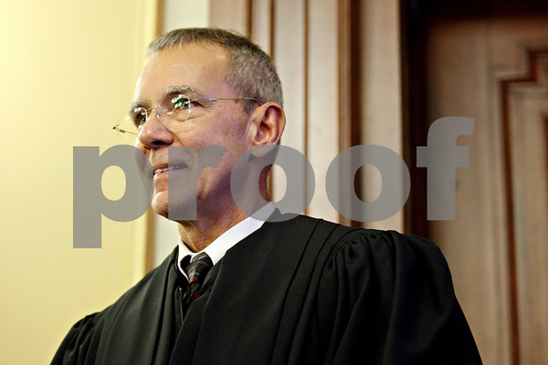 Rob Winner – rwinner@daily-chronicle.com<br /> <br /> Tom Doherty the 16th Circuit's newest judge looks out toward his family and friends after being sworn in on Monday afternoon at the DeKalb County Courthouse in Sycamore.