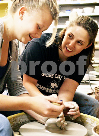 Rob Winner – rwinner@daily-chronicle.com<br /> <br /> Jess Emrich, 15 of Hampshire, receives instruction from Casey Hinkson, of DeKalb, during a pottery class at The Art Attack in Sycamore, Ill. on Tuesday June 8, 2010.