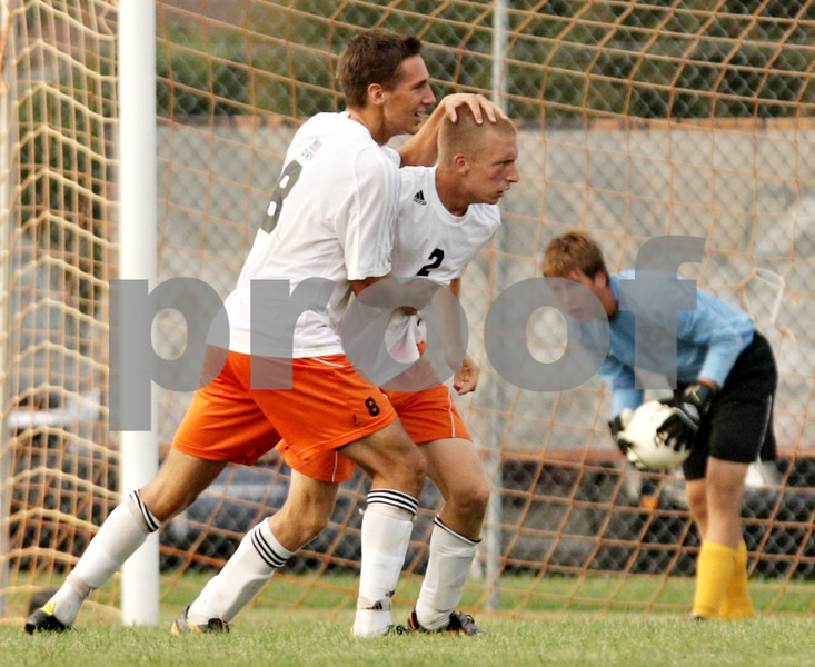 Beck Diefenbach - bdiefenbach@daily-chronicle.com<br /> <br /> DeKalb's Joe Ferguson (8, left) congratulates Sammy Lake (2) after scoring a goal during the second half of the game at DeKalb High School in DeKalb, Ill., on Tuesday Aug. 24, 2010. DeKalb and Hononegah tied 1 to 1.