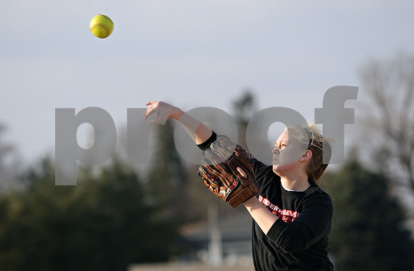 Beck Diefenbach  -  bdiefenbach@daily-chronicle.com<br /> <br /> Indian Creek senior Sarah Chapman throws the ball during practice at Indian Creek High School in Shabbona, Ill., on Friday March 19, 2010.