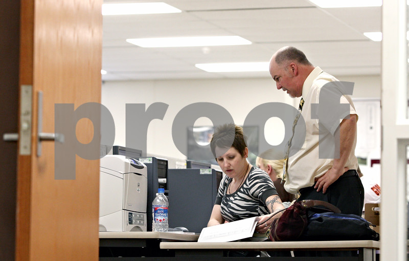 Rob Winner – rwinner@daily-chronicle.com<br /> <br /> Carrie Groen (left) of Dixon receives help from instructor Mark Schwendau while working on a Computer-aided design project on Thursday April 15, 2010 at Kishwaukee College in Malta, Ill. This week is National Design Drafting Week, as proclaimed by the American Design Drafting Association.