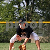 Beck Diefenbach  -  bdiefenbach@daily-chronicle.com<br /> <br /> Sycamore's Nathan Harbecke picks up a ground ball during practice at Sycamore High School in Sycamore, Ill., on Monday May 24, 2010.