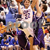 Beck Diefenbach  -  bdiefenbach@daily-chronicle.com<br /> <br /> Genoa-Kingston's Nick Lopez (22, left) tries to shoot the ball around Hampshire's Justin Bieber (12) during the third quarter of the game at Genoa-Kingston High School in Genoa, Ill., on Monday Jan. 11, 2009. Hampshire defeated G-K 57 to 52.