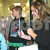Dana  Herra dherra@daily-chronicle.com<br /> <br /> Face painter Vicky Gurley shows Joyenne Ross, 5, of DeKalb her finished cat makeup Sunday at a blood drive and family fun day sponsored by the Adventure Guides at the Kishwaukee Family YMCA.