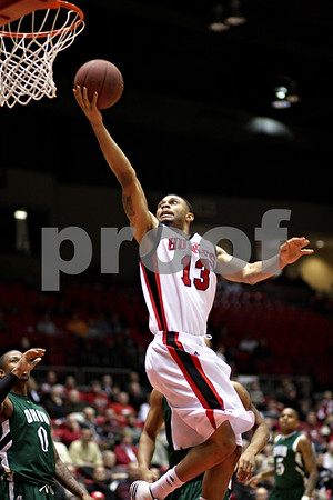Beck Diefenbach  -  bdiefenbach@daily-chronicle.com<br /> <br /> Northern Illinois' Xavier Silas (13) shoots the ball during the first half of the game against Ohio at NIU's Convocation Center in DeKalb, Ill., on Wednesday Jan. 27, 2010.