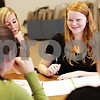 Beck Diefenbach  -  bdiefenbach@daily-chronicle.com<br /> <br /> DeKalb freshman Emily Sebree (right) gets help with her Algebra homework from numerous Northern Illinois University student teachers during the Student Tutors and Resources program at DeKalb High School on Wednesday Feb. 3, 2010.