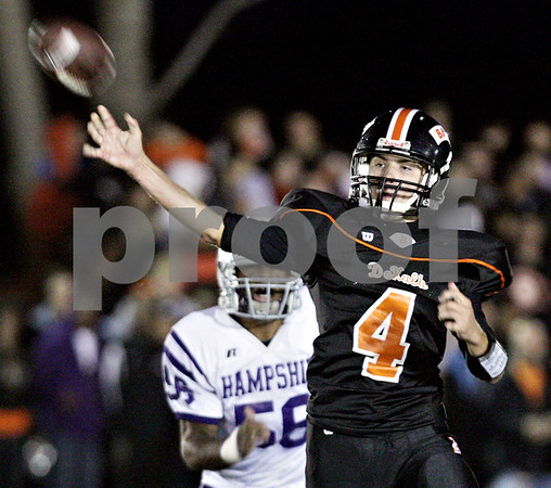 Beck Diefenbach  -  bdiefenbach@daily-chronicle.com<br /> <br /> DeKalb quarterback Bobby Russell (4) passes the ball during the first quarter of the game against Hampshire at DeKalb High School in DeKalb, Ill., on Friday Sept. 3, 2010.