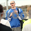 Beck Diefenbach  -  bdiefenbach@daily-chronicle.com<br /> <br /> Genoa-Kingston's head coach Barry Schmidt talks to his players during track practice at Genoa-Kingston High School in Genoa, Ill., on Tuesday March 16, 2010.