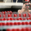 Kyle Bursaw – kbursaw@daily-chronicle.com<br /> <br /> Kaneland High School's Grant Alef adjusts his goggles while practicing at the Kishwaukee YMCA Tuesday, Dec. 7, 2010.