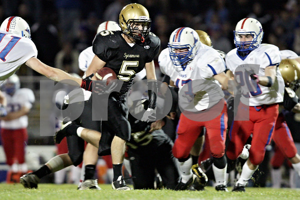 Rob Winner – rwinner@daily-chronicle.com<br /> <br /> Sycamore running back Eric Ray runs up the middle after a reception for a touchdown in the second quarter of a Class 5A first-round playoff game in Sycamore, Ill. on Saturday October 30, 2010. Sycamore went on to defeat Lakes, 36-3.