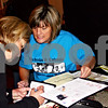 Caitlin Mullen  -  cmullen@daily-chronicle.com<br /> <br /> Carol Hemmerich (left), of Sycamore, purchases items from Molly Koertner, of Malta, at the Girls Night Out For a Cure event at Taxco Restaurant in Sycamore, Ill., on Friday May 14, 2010. The fundraiser collected money for the Nick's Friends Relay for Life team, in memory of Nick Calendo, who died of colon cancer last August.