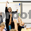 "Rob Winner – rwinner@daily-chronicle.com<br /> <br /> Second grade teacher Pam Reilly, of Woodbury Elementary School in Sandwich, Ill., uses ""Hot Dots,"" which are reading comprehension cards during class time on Wednesday September 29, 2010. The ""Hot Dots"" were purchased by donations made through a website called DonorsChoose.org."