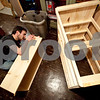 Beck Diefenbach – bdiefenbach@daily-chornicle.com<br /> <br /> Lining up the parts for the drawers of the dressers caused many problems as Kevin builds the last one for the unit on Jan 15, 2009.