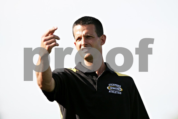 Rob Winner – rwinner@daily-chronicle.com<br /> <br /> Sycamore coach Dave Lichamer signals to one of his players during the first half of the IHSA Class 2A Barrington Super-Sectional on Tuesday June 1, 2010 in Barrington, Ill. Saint Viator defeated Sycamore, 3-0.