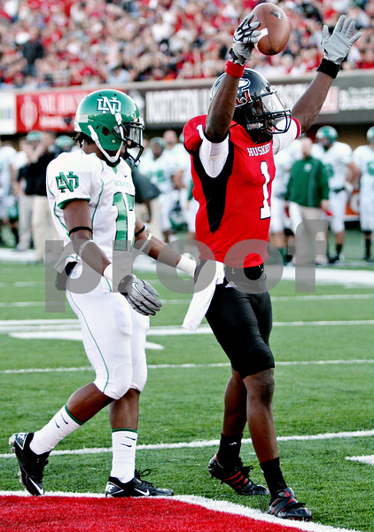 Rob Winner – rwinner@daily-chronicle.com<br /> <br /> Northern Illinois wide receiver Martel Moore celebrates his touchdown grab during the first quarter against North Dakota in DeKalb, Ill. on Saturday September 11, 2010. Northern Illinois went on to defeat North Dakota, 23-17.