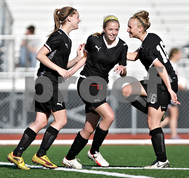 Beck Diefenbach  -  bdiefenbach@daily-chronicle.com<br /> <br /> From right, Sycamore's  Lindsey Hemmerich (16) and Rachel Stueber (22) congratulate Katelyn Brown (11) after scoring a goal against DeKalb during the first half of the game at Northern Illinois University in DeKalb, Ill., on Thursday April 29, 2010. Sycamore defeated DeKalb 2 to 0.