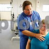 Rob Winner – rwinner@daily-chronicle.com<br /> <br /> Between exercises, Ken Schwiesow (left), RCP, CPFT, a pulmonary rehabilitation coordinator at Kishwaukee Community Hospital in DeKalb, Ill. uses a stethoscope to listen to Rose Cimaroli's airways for any wheezing during Cimaroli's pulmonary rehabilitation session on Wednesday July 28, 2010. Cimaroli was diagnosed with chronic obstructive pulmonary disease, or COPD, about 10 years ago.