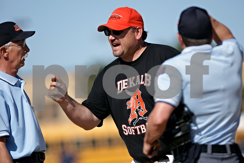 Beck Diefenbach  -  bdiefenbach@daily-chronicle.com<br /> <br /> DeKalb head coach Jeff Davis argues with referees after an interference call during the first inning of the IHSA Class 2A Regional semi final game against DeKalb at Sycamore High School in Sycamore, Ill., on May 27, 2010.