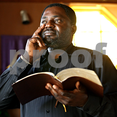 Beck Diefenbach  -  bdiefenbach@daily-chronicle.com<br /> <br /> Pastor Ngum Eric Mangek of Victory Baptist Church in DeKalb, Ill., on Wednesday May 5, 2010.
