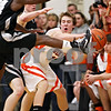 Beck Diefenbach - bdiefenbach@daily-chronicle.com<br /> <br /> DeKalb Chris Calbow (10) tires to pass the ball but it is kicked out of bounds during the fourth quarter of the IHSA Class 3A Regional championship game against Kaneland at Kaneland High School in Maple Park, Ill., on Friday March 3, 2010.