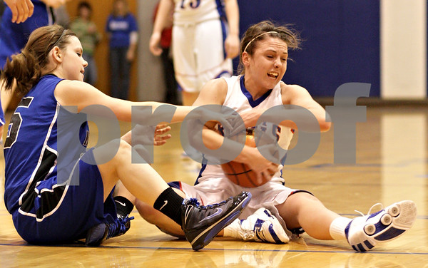 Beck Diefenbach  -  bdiefenbach@daily-chronicle.com<br /> <br /> Hinckley-Big Rock's Kaitlin Phillips (14, right) strips the ball from Newark's Miranda Schmidt (15, left) during the third quarter of the little ten tournament championship game against Newark at H-BR in Hinckley, Ill., on Friday Jan. 22, 2010. H-BR defeated Newark 63 to 39.