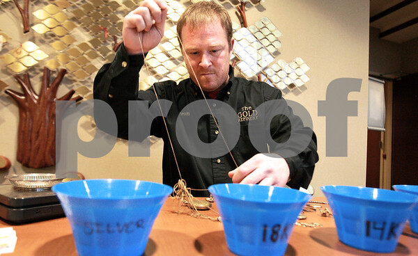 Kyle Bursaw – kbursaw@daily-chronicle.com<br /> <br /> Aaron Brunson, of The Gold Refinery, untangles some jewelry brought in my a staff member of Kishwaukee Hospital in DeKalb, Ill. on Nov. 12, 2010. After appraising the gold, Brunson awarded the client with $140.