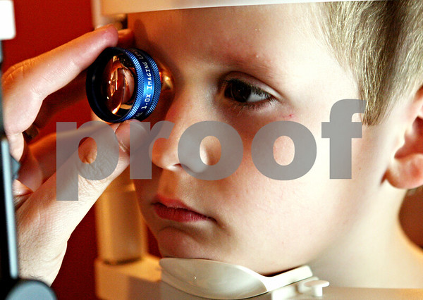 Rob Winner – rwinner@daily-chronicle.com<br /> <br /> Five-year-old Isaac Thibeault, of Sycamore, has his eyes examined at Spex Express in Sycamore, Ill. on Wednesday August 18, 2010.Thibeault will be entering kindergarten in Sycamore this week.<br /> <br /> **this week as in the week of Aug. 15 - 21. Wednesday Aug. 25 to be exact.