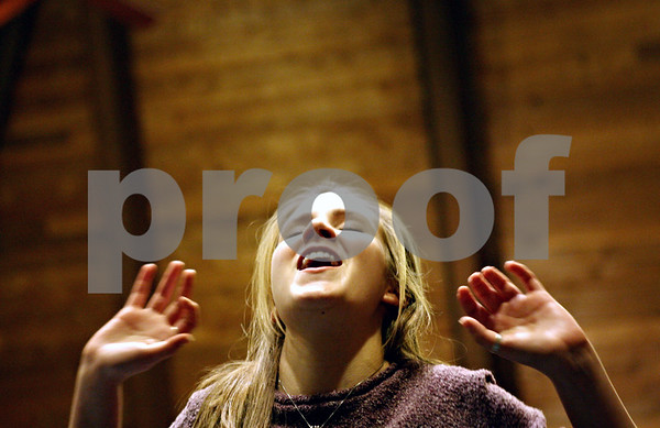 "Rob Winner – rwinner@daily-chronicle.com<br /> <br /> Kiah Fischer, 16 of Sycamore, sings during rehearsal for ""Thoroughly Modern Millie"" at Westminster Presbyterian Church in DeKalb on Monday night."