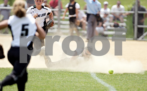 Rob Winner – rwinner@daily-chronicle.com<br /> <br /> Kaneland's Allyson O'Herron is unable to catch a blooper that falls into left field in the sixth inning of the IHSA Class 3A Sycamore Regional championship game on Saturday May 29, 2010 in Sycamore, Ill. Sycamore went on to defeat Kaneland, 6-3.