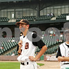Beck Diefenbach  -  bdiefenbach@daily-chronicle.com<br /> <br /> DeKalb's Tyler Gosnell (17, left) and Travis Jones (3) look on as teammates Brian Sisler and Jake Gordon are tended to after colliding during the first inning of the IHSA Class 3A State Semifinal Game against Marian Central in Joliet, Ill., on Friday June 11, 2010.