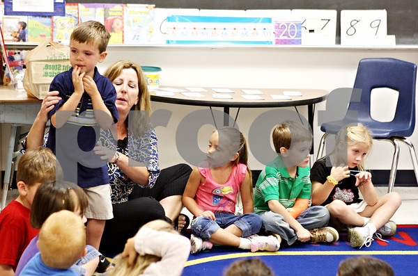 Rob Winner – rwinner@daily-chronicle.com<br /> <br /> Five-year-old Bryce Overton looks back at his parents as his new kindergarten teacher Ann Sullivan tries to ease his uncertainty as the first day of classes begin at Hiawatha Elementary School in Kirkland, Ill. on Tuesday August 17, 2010.