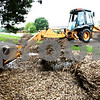 Rob Winner – rwinner@daily-chronicle.com<br /> <br /> A village of Waterman employee uses a backhoe loader to clear debris from a drainage ditch near the intersection of Duffy and Waterman Roads on Thursday May 13, 2010.