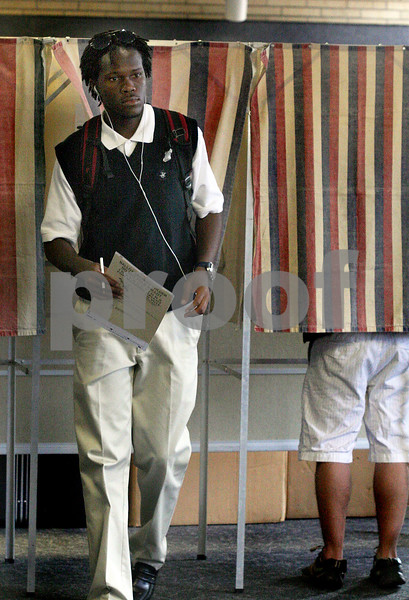 Wendy Kemp - For The Daily Chronicle<br /> NIU student Rapheal Udeaja, Jr. finishes voting at the NIU Holmes Student Center on Monday.<br /> DeKalb 10/18/10