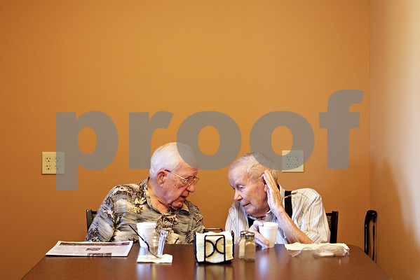 Beck Diefenbach  -  bdiefenbach@daily-chronicle.com<br /> <br /> Cliff Johnson (left) and John Blair talk over morning coffee at Oak Crest Retirement Center's new coffee shop, Café de Feuille de Chêne, in DeKalb, Ill., on Monday Aug. 30, 2010.