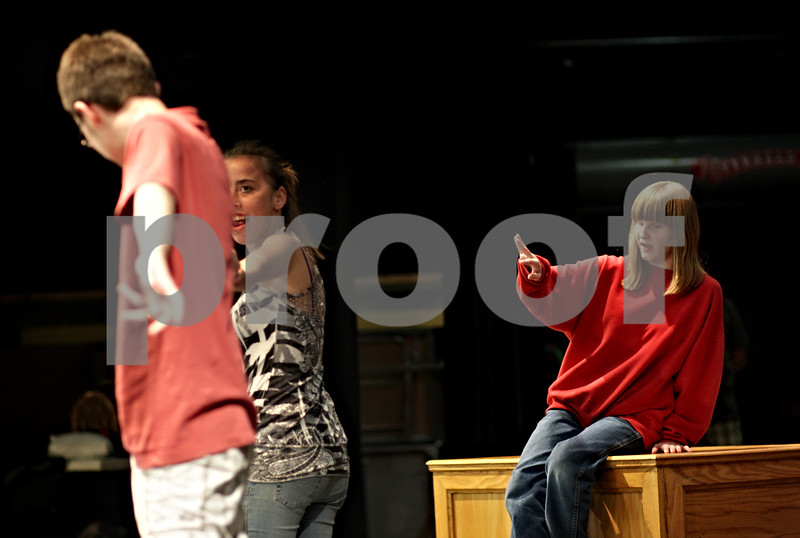 """Beck Diefenbach – bdiefenbach@daily-chronicle.com<br /> <br /> Haley Tyrrell (right), plays the role of Miss Hannigan during rehearsal for The Penguin Project's production of """"Annie Jr."""" at Sycamore High School in Sycamore, Ill., on Tuesday Sept. 14, 2010."""