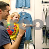 Rob Winner – rwinner@daily-chronicle.com<br /> <br /> While looking to save money by taking advantage of the sales tax holiday, high school teacher Eric Hill, of DeKalb, shops for new shirts with his son Logan, 2, at the JCPenney in DeKalb, Ill. on Friday August 6, 2010.