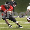 Kyle Bursaw - kbursaw@daily-chronicle.com<br /> <br /> Northern Illinois running back Chad Spann (28) finds a hole to evade Toledo cornerback Byron Best (6) during the first half in DeKalb, Ill. on Nov. 9, 2010.