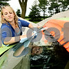 Rob Winner – rwinner@daily-chronicle.com<br /> <br /> Powder puff race car driver Danielle Heath, of Rolling Meadows, cleans her windshield on her 1986 Chevrolet Caprice at Sycamore Speedway in Maple Park, Ill. on Friday July 30, 2010.