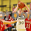 Rob Winner – rwinner@daily-chronicle.com<br /> <br /> Sycamore's Jessica Pluhm puts up two during the first quarter in Sycamore, Ill. on Tuesday December 7, 2010.