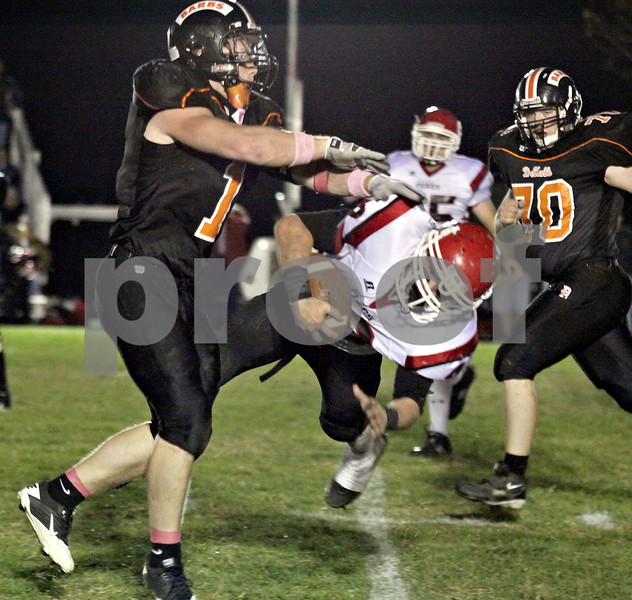 Wendy Kemp - For The Daily Chronicle<br /> DeKalb's Troy Talaga stops Yorkville's James Milschewski during Friday's game.<br /> DeKalb 10/15/10