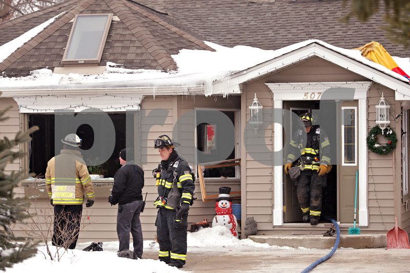 Beck Diefenbach  -  bdiefenbach@daily-chronicle.com<br /> <br /> DeKalb firefighters exit a home at 507 S. Second St., in Malta, Ill., following a blaze which was stopped with help from Malta and Shabbona firefighters on Wednesday Jan. 20, 2009.