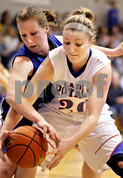 Beck Diefenbach  -  bdiefenbach@daily-chronicle.com<br /> <br /> Hinckley-Big Rock's Jenna Thorp (20) tries to keep the ball away from Newark's   Tara Bernard (14) during the third quarter of the game at H-BR High School in Hinckley, Ill., on Thursday Jan. 14, 2010. H-BR defeated Newark 46 to 30.