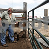 Beck Diefenbach  -  bdiefenbach@daily-chronicle.com<br /> <br /> Chauncy Watson holds a sheep while wrangling a herd at his farm south of DeKalb on Saturday August 21, 2010. Taking the sheep to market is many of the farm jobs which the Watsons have had to continue despite not yet replacing their home which burned down on April 30, 2010.