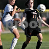 Beck Diefenbach  -  bdiefenbach@daily-chronicle.com<br /> <br /> Sycamore's Lindsey Hemmerich (16, left) goes after a loose ball during the second half of the IHSA Class 2A sectional final game against Freeport at Hampshire High School in Hampshire, Ill., on Friday May 28, 2010.