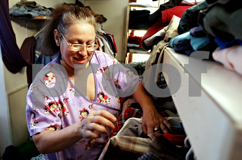 """Rob Winner – rwinner@daily-chronicle.com<br /> <br /> DeKalb resident Linda Maffei looks through items of clothing at the Blessing Well of the First Church of the Nazarene in DeKalb, Ill. on Wednesday August 11, 2010. """"It's about the emotional support as much as the food and clothes,"""" said Maffei about the volunteers who help at the Blessing Well."""