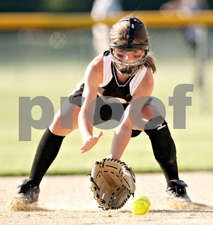 Beck Diefenbach  -  bdiefenbach@daily-chronicle.com<br /> <br /> DeKalb Hurricanes' Payton Montgomery (72) field a ground ball during the 10U game against the Cary Crush in the pool play portion of the Storm Dayz softball tournament at Sycamore Park in Sycamore, Ill., on Friday June 25, 2010.