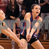 Kyle Bursaw - kbursaw@daily-chronicle.com<br /> <br /> Sarah Paver (77) and Kaitlin Phillips (14) both via for the ball in the IHSA Girls Volleyball Regional on Saturday Oct. 30, 2010 at Hinckley-Big Rock High School.